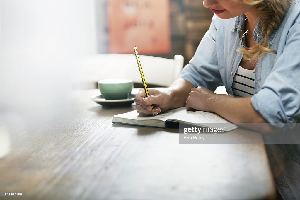 Woman working in a coffee shop : Stock Photo