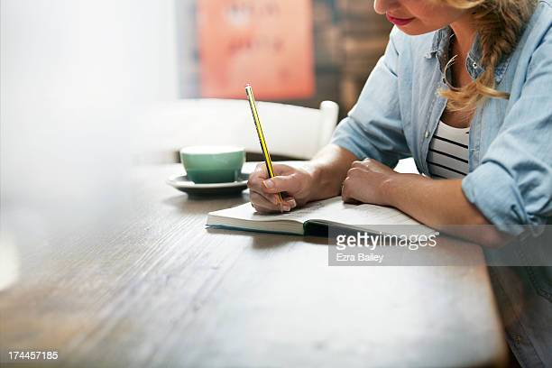 woman working in a coffee shop - writing stock pictures, royalty-free photos & images