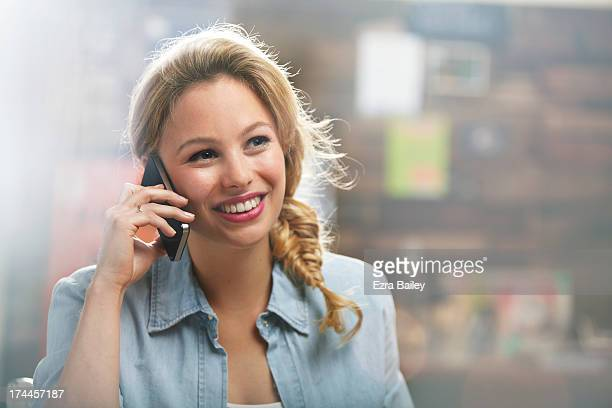 woman on her mobile phone in a coffee shop - blonde hair stock pictures, royalty-free photos & images