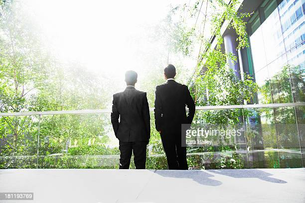 two businessmen surrounded by trees. - environment stock pictures, royalty-free photos & images