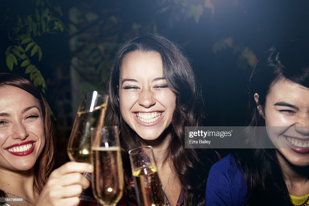 Friends drinking Champagne at a party. : Stock Photo