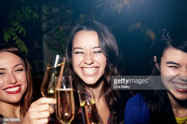 Friends drinking Champagne at a party.