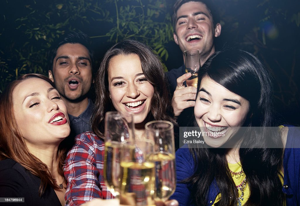 Friends celebrating with Champagne at a party. : Stock Photo