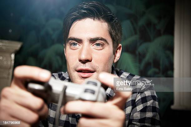 portrait of a man playing computer game - competition stock pictures, royalty-free photos & images