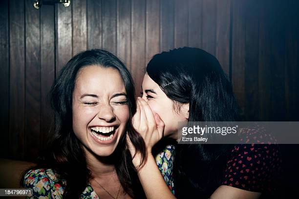 friends whispering to each other. - laughing stock pictures, royalty-free photos & images