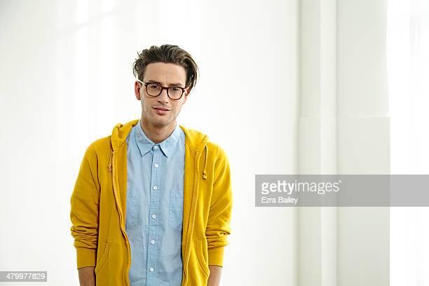 portrait of a young creative wearing glasses - cardigan photos et images de collection