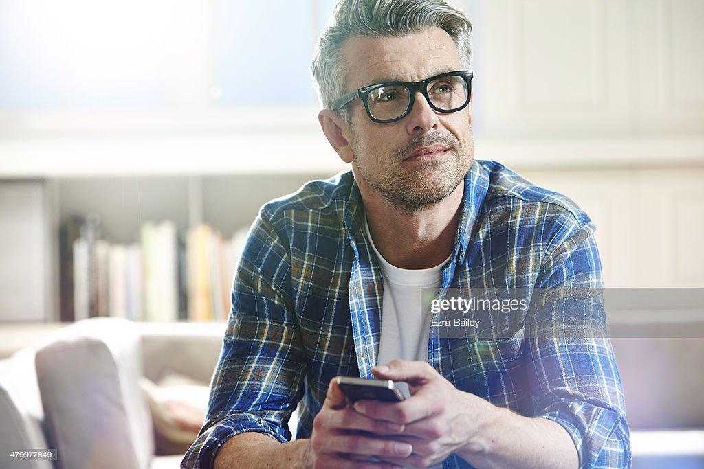 Thoughtful man relaxing at home. : Foto de stock