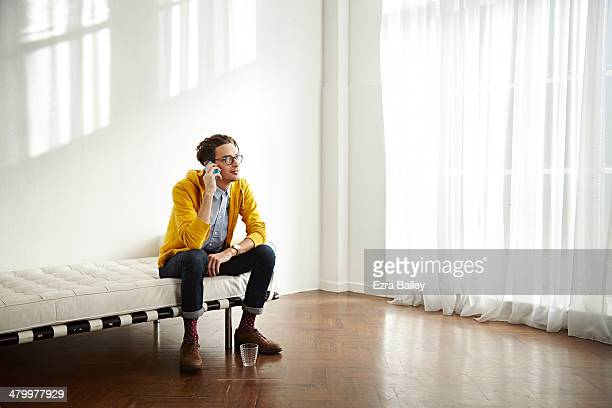 Man chatting on his mobile phone in apartment.