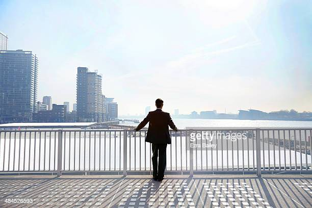 businessman looking out over the city. - day stock pictures, royalty-free photos & images