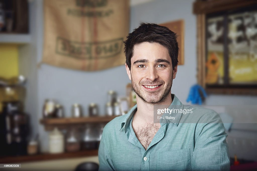 Portrait of a coffee shop owner : Stock Photo