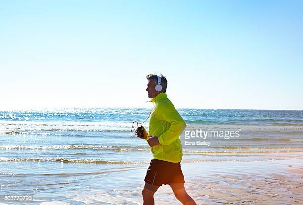 Man exercising on the beach with headphones on