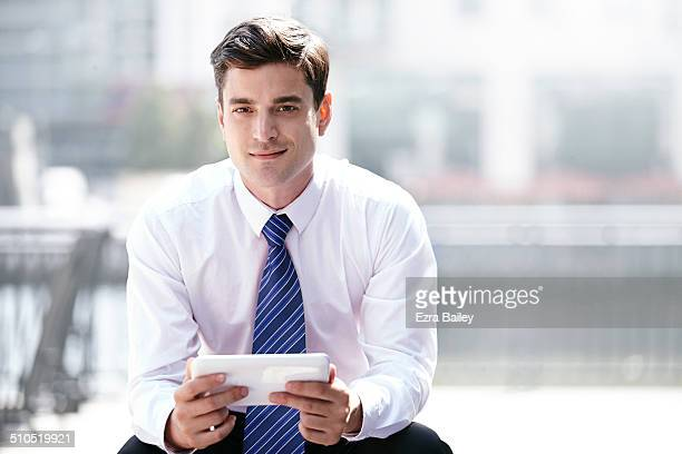 Portrait of Businessmen with digital tablet.