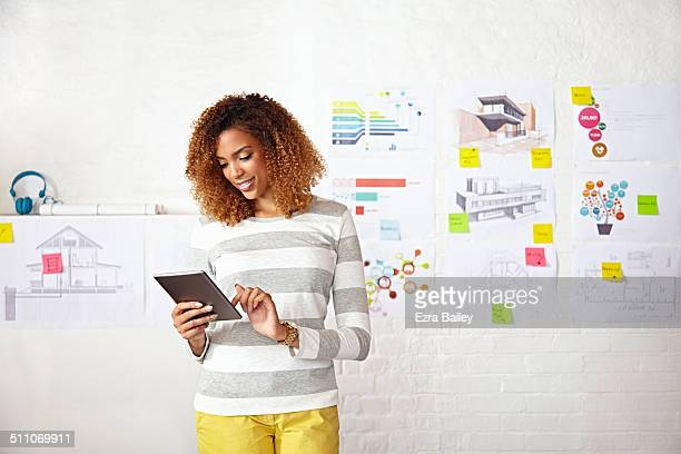Office worker using a digital tablet to brainstorm