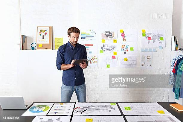 office worker brainstorming in creative office. - shirt stock pictures, royalty-free photos & images