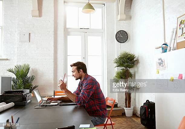 Male employee working in a creative office.