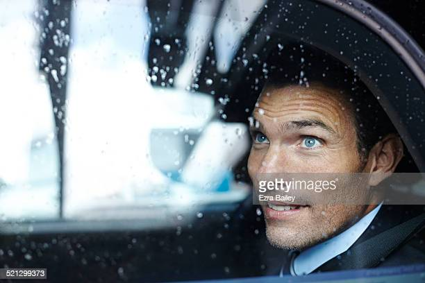 a businessman looks from a taxi window - stubble stock pictures, royalty-free photos & images