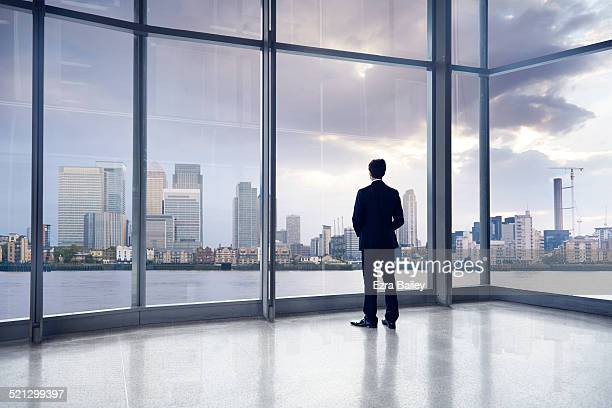 A businessman looking out over a cityscape.
