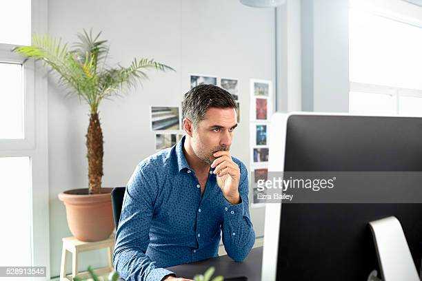 Office worker using a computer in creative space.
