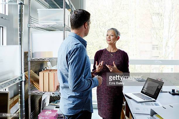 business colleagues discussing ideas in an office. - advice stock pictures, royalty-free photos & images