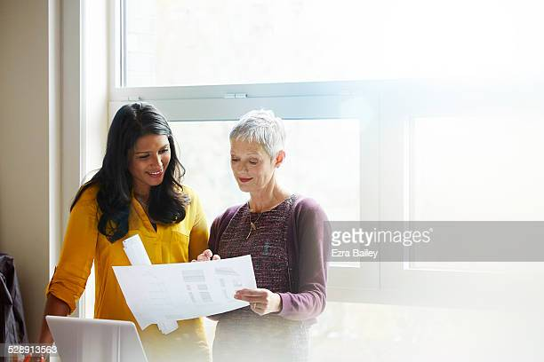 Business women discussing plans together.