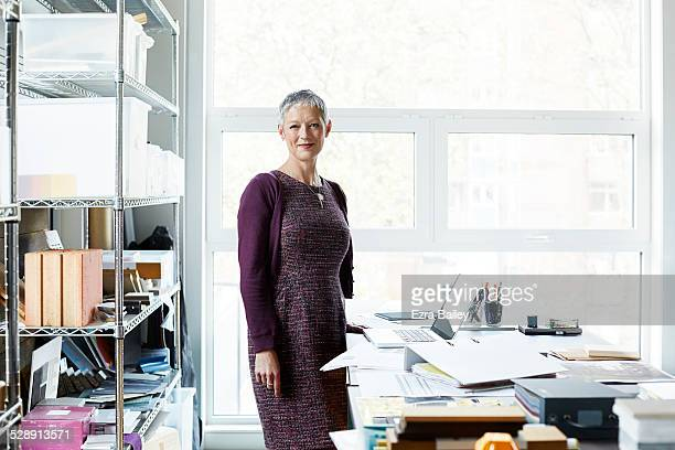 portrait of a business woman in creative office. - purple dress stock pictures, royalty-free photos & images