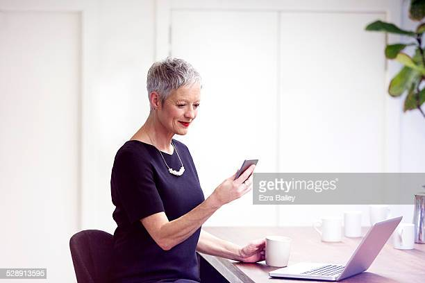 Portrait of a mature business woman using a mobile
