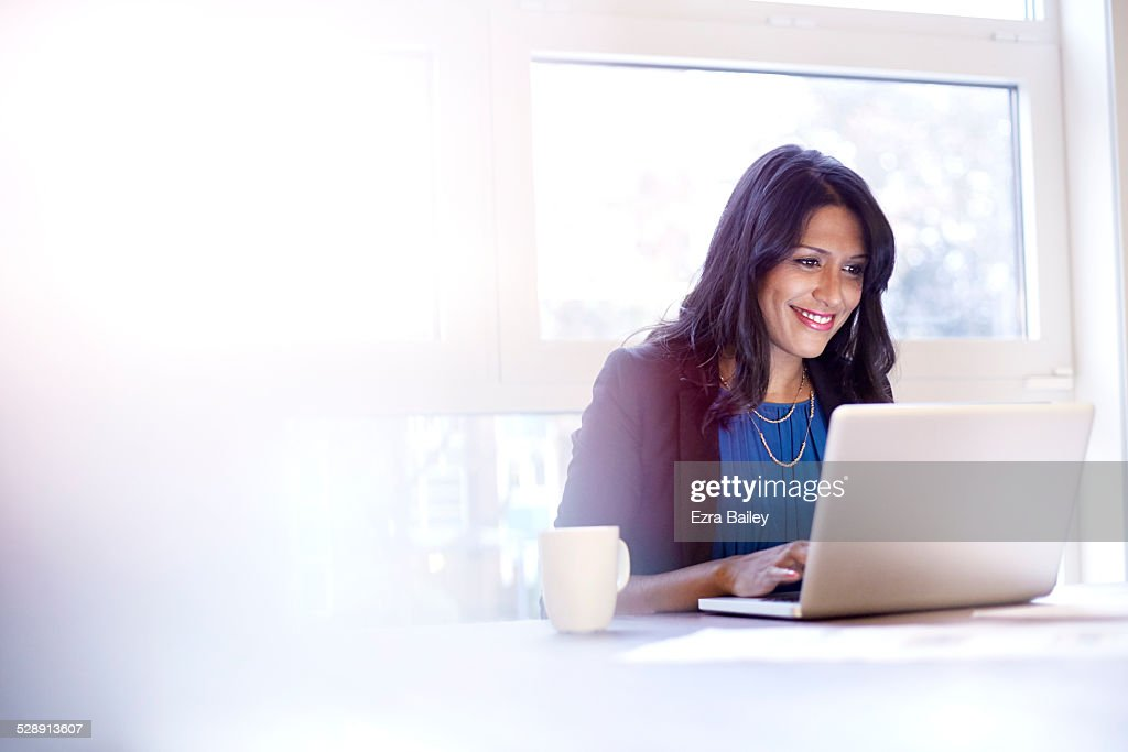 Young business woman working on a laptop. : Stock Photo