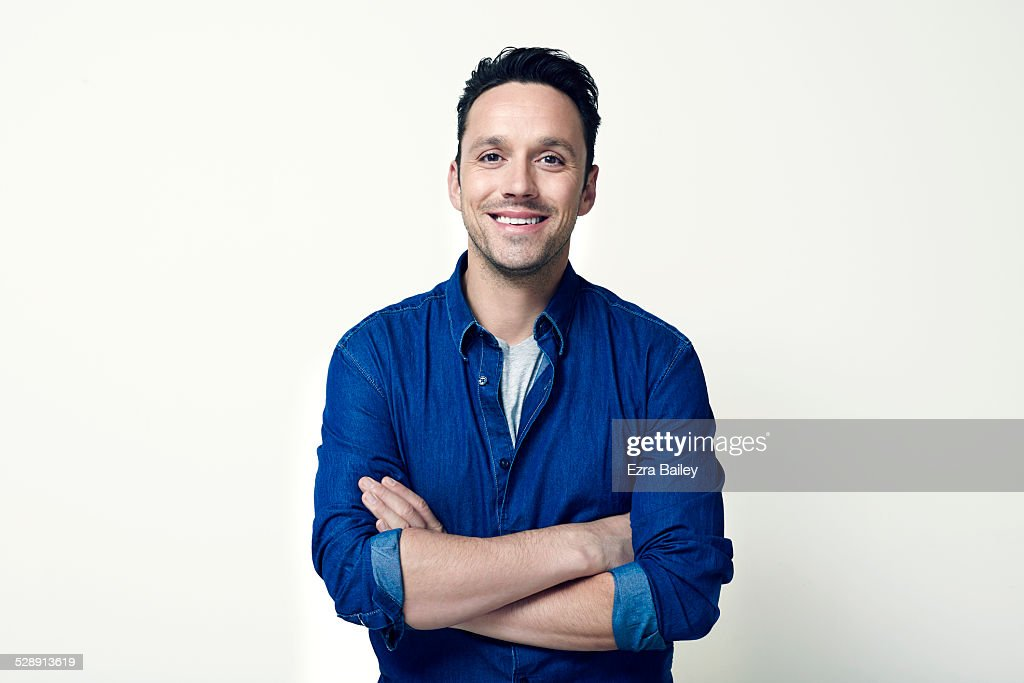 Portrait of a young guy with arms folded. : Stock Photo