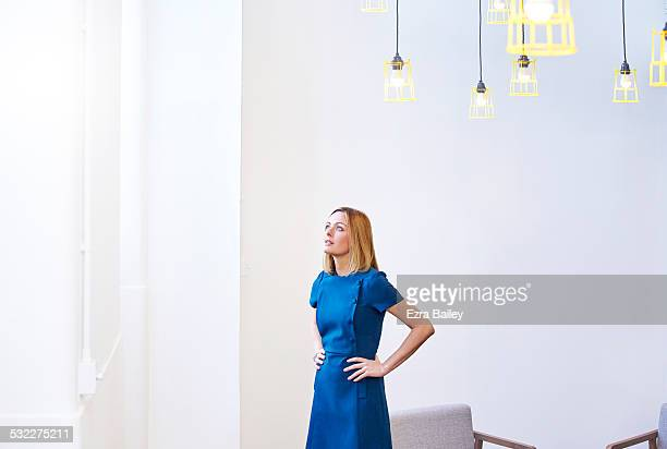 female office worker looking for inspiration. - dress stock pictures, royalty-free photos & images