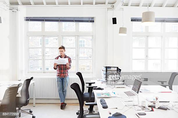working in modern open plan office. - trousers stock pictures, royalty-free photos & images