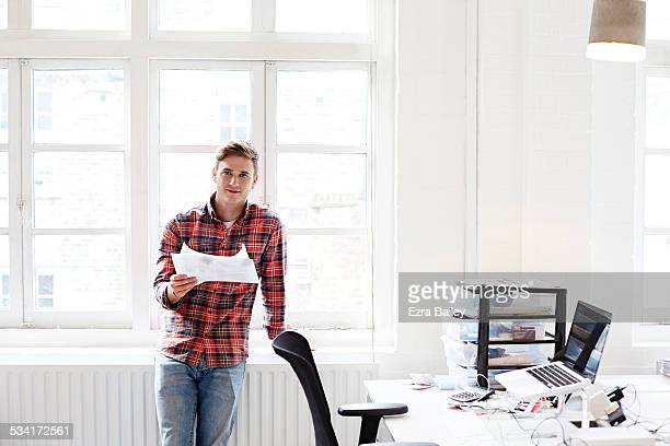 Honest portrait of a creative person in an office