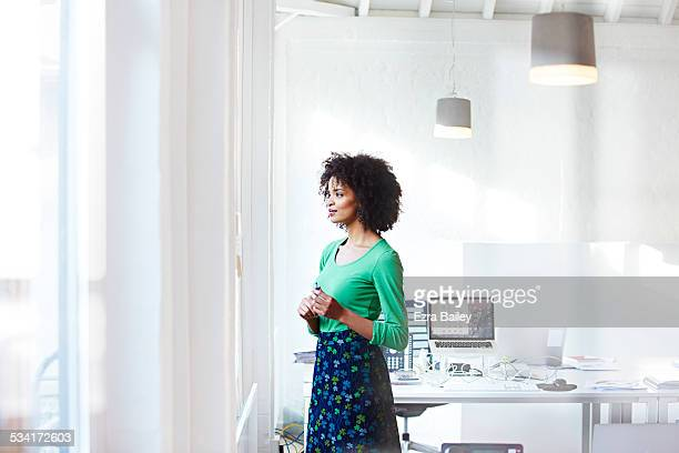 businesswoman staring out the window thinking. - introspection stock pictures, royalty-free photos & images
