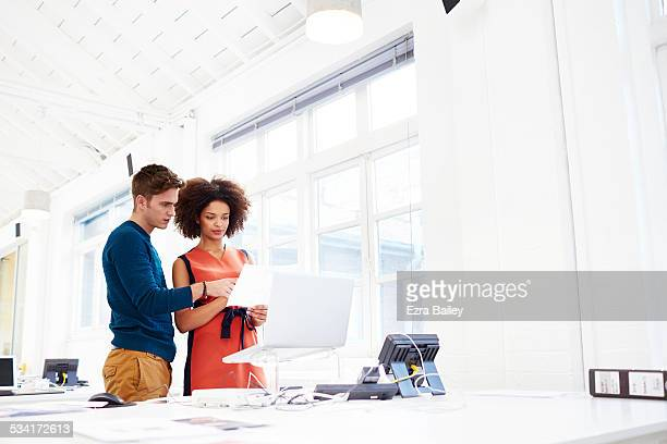 colleagues discussing ideas in open play office. - image stock pictures, royalty-free photos & images