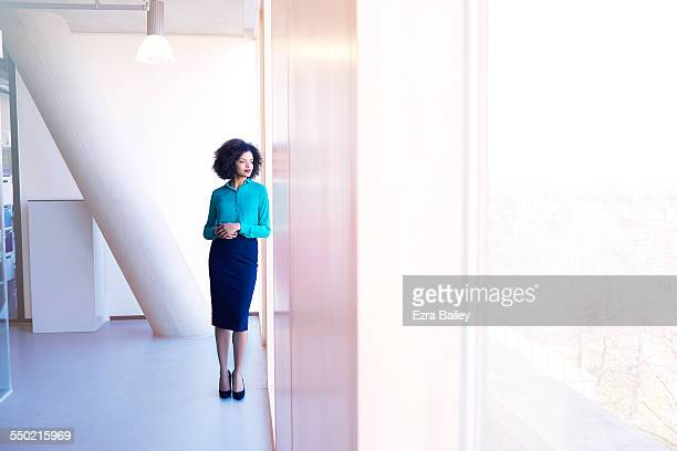 Businesswoman thinking as she looks over city