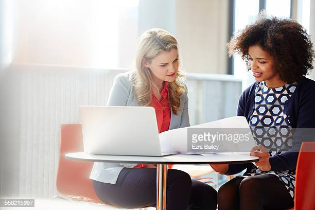 Two businesswomen discussing plans
