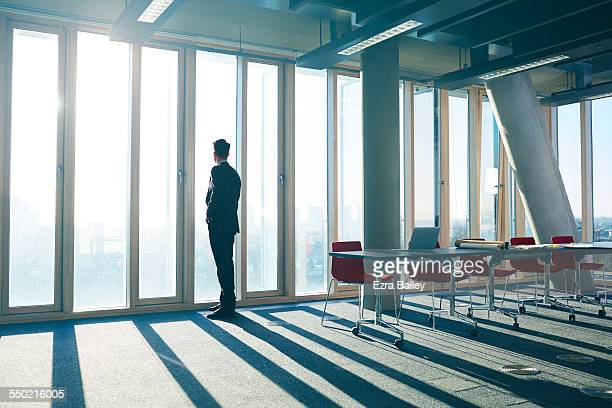 businessman looking out of office over city - the way forward stock pictures, royalty-free photos & images