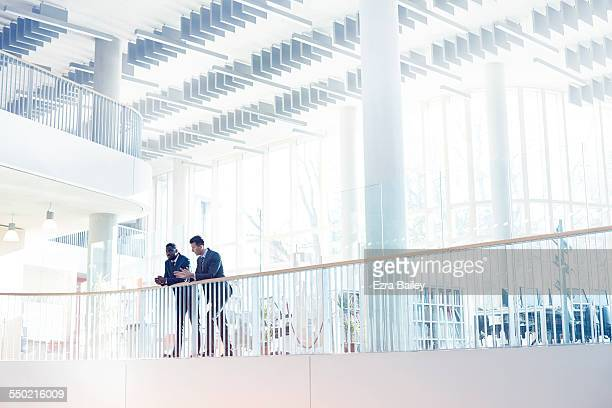 businessmen discussing plans in modern office - coworker stock pictures, royalty-free photos & images
