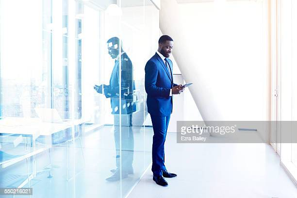Businessman standing using a tablet