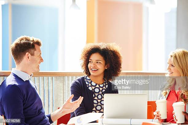 co-workers discussing project over coffee - skill stock pictures, royalty-free photos & images
