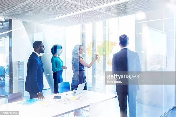 businesspeople in meeting room in modern office - strategy stock pictures, royalty-free photos & images