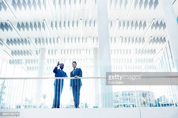 businessmen discussing ideas in open plan office - skill stock pictures, royalty-free photos & images