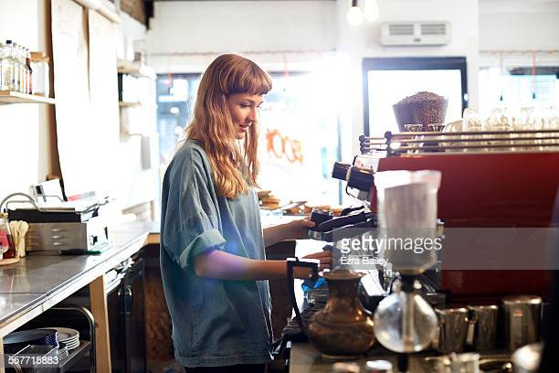 small business owner works behind cafe counter - owner stock pictures, royalty-free photos & images