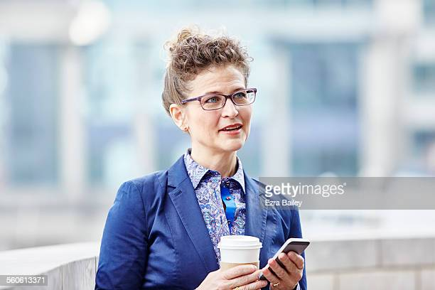 successful businesswoman talks with colleagues - looking away stock pictures, royalty-free photos & images