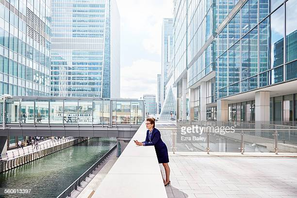 Experienced businesswoman with smartphone in city
