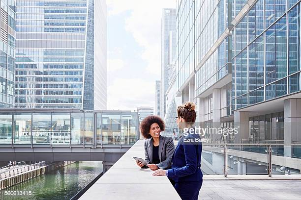 senior executive women discussing plans together - partnership stock pictures, royalty-free photos & images