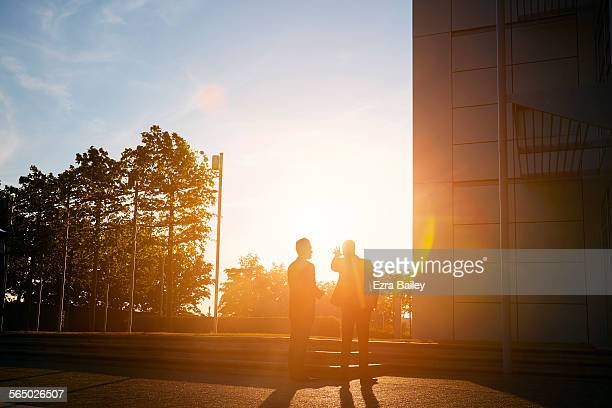 Two businessmen discussing plans in sun