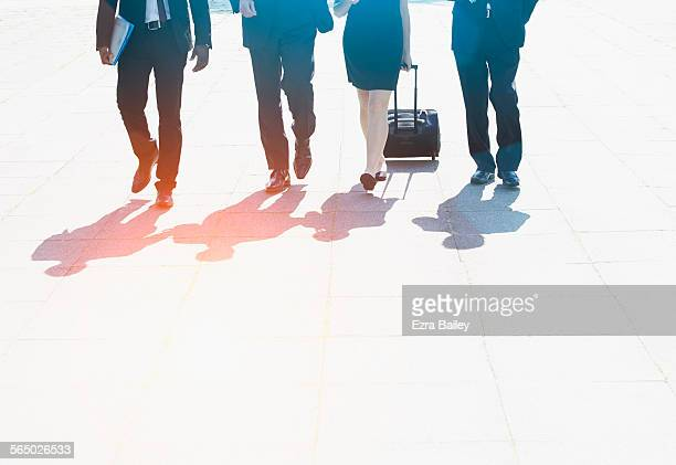 Business men and woman walking through the city