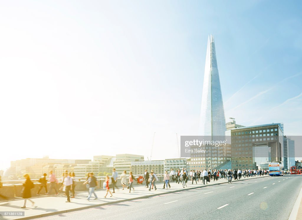Walking to work through the city at sunrise : Stock Photo