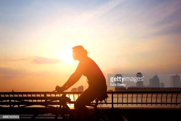 commuter cycling to work in the morning. - image stock pictures, royalty-free photos & images