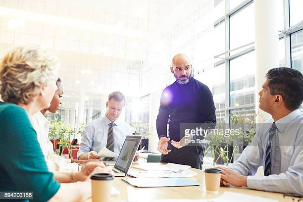 an impromptu brainstorm meeting in modern office. - business meeting stock pictures, royalty-free photos & images